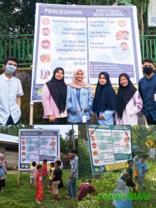 Kukerta Relawan Universitas Riau pasang baliho Sosialisasi Covid 19 di Hulu Kuantan